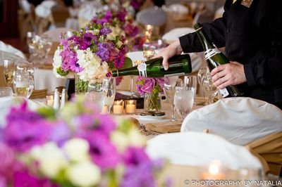 Champagne being poured at an outdoor wedding.